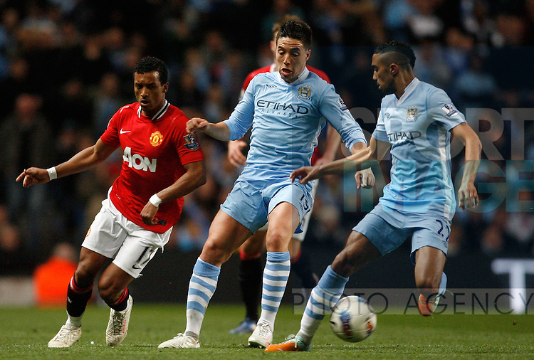 Manchester City's Samir Nasri (C) in action with Manchester United's Nani (L)..Barclays Premier League match between Manchester City and Manchester United at the Etihad Stadium, Manchester on the 30th April 2012..Sportimage +44 7980659747.picturedesk@sportimage.co.uk.http://www.sportimage.co.uk/.