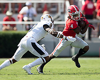 ATHENS, GA - SEPTEMBER 7: James Cook #4 tries to evade Dior Johnson #9 during a game between Murray State Racers and University of Georgia Bulldogs at Sanford Stadium on September 7, 2019 in Athens, Georgia.