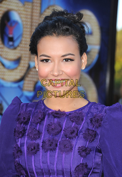 Naya Rivera .attends The 20th Century Fox 'Glee 3D' Concert World Movie Premiere held at The Regency Village theatre in Westwood, California, USA, .August 6th 2011..portrait headshot purple hair up smiling beauty  shoulders pompoms .CAP/RKE/DVS.©DVS/RockinExposures/Capital Pictures.