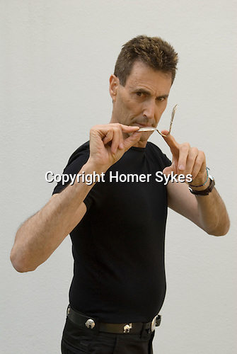 Uri Geller at home Berkshire England 2008. Bending spoon 5th image taken at 16. 37. 32 pm.