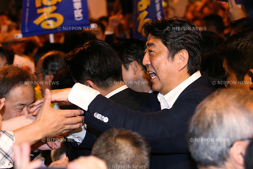 Japanese Prime Minister and ruling Liberal Democratic Party (LDP) president Shinzo Abe attends a stump speech in support of local LDP candidates in Akihabara district, Tokyo, Japan on July 9, 2016. Japan's Upper House election will be held on July 10. (Photo by AFLO)