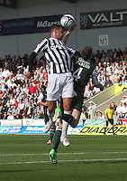 Steven Thompson wins the header from Paul Hanlon in the St Mirren v Hibernian Clydesdale Bank Scottish Premier League match played at St Mirren Park, Paisley on 18.8.12.