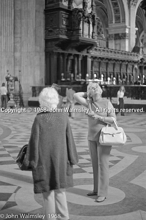 Two ladies admiring the ceiling in St.Paul's Cathedral, London.  1968.
