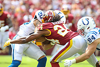 Landover, MD - September 16, 2018: Washington Redskins defensive back Josh Norman (24) tries  to tackle Indianapolis Colts running back Jordan Wilkins (20) during the  game between Indianapolis Colts and Washington Redskins at FedEx Field in Landover, MD.   (Photo by Elliott Brown/Media Images International)