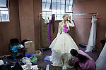 JOHANNESBURG, SOUTH AFRICA - FEBRUARY 14: A model is dressed for the Klûk CGDT label during a fitting in preparation for the Joburg Fashion Week on February 14, 2011, in Johannesburg, South Africa. Klûk CGDT, created by the designers Malcolm KLûK and Christiaan Gabriel Du Toit and their brand is not so much about clothes, but rather life and a holistic experiential, boundary blurring approach to style that encompasses all the senses. Trends influencing their collection include touches of tribal, vintage and the baroque. Their couture collection only to order. (Photo by Per-Anders Pettersson)
