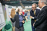 Madeline Sudnick (Left) presents her research to  Vice President for Research; and Dean of the Graduate College Joe Shields (Center) and President Nellis at the Student Expo. Photo by Ben Siegel
