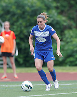 Boston Breakers midfielder Heather O'Reilly (9) gains momentum. In a National Women's Soccer League (NWSL) match, Seattle Reign FC (white) defeated Boston Breakers (blue), 2-1, at Dilboy Stadium on June 26, 2013.