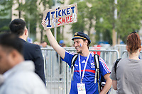 MOSCOW, RUSSIA - June 14, 2018: A French fan looks for a ticket for the opening match of the FIFA 2018 World Cup at Luzhniki Stadium.