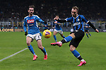 Christian Eriksen of Inter crosses the ball as he is closed down by Fabian Ruiz of Napoli during the Coppa Italia match at Giuseppe Meazza, Milan. Picture date: 12th February 2020. Picture credit should read: Jonathan Moscrop/Sportimage