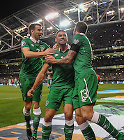 16/11/2015;UEFA 2016 European Championship Play-Off Ireland vs Bosnia-Herzegovina 2nd Leg,Aviva Stadium,Dublin <br /> Ireland&rsquo;s Jonathan Walters celebrates with Seamus Coleman and Daryl Murphy after scoring from a penalty.<br /> Photo Credit: actionshots.ie/Tommy Grealy