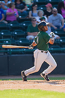 Cristian Paulino (31) of the Augusta GreenJackets follows through on his swing against the Hickory Crawdads at L.P. Frans Stadium on May 11, 2014 in Hickory, North Carolina.  The GreenJackets defeated the Crawdads 9-4.  (Brian Westerholt/Four Seam Images)