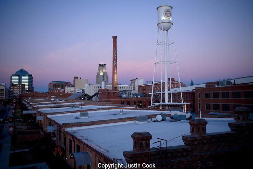 The Lucky Strike water tower glows with Christmas lights at the American Tobacco Campus in downtown Durham, NC. The downtown Durham skyline at sunset,