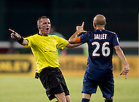 Christophe Jallet (26) of Paris Saint-Germain FC argues with referee John McCloskey during the game at RFK Stadium in Washington, DC.  Paris Saint-Germain FC tied D.C. United, 1-1.