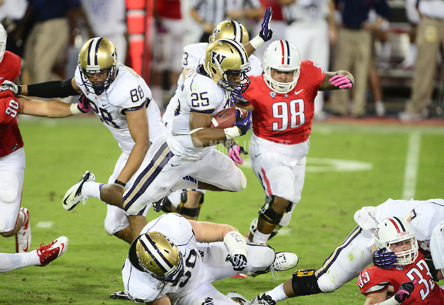 Oct. 20, 2012; Tempe, AZ, USA; Washington Huskies tailback (25) Bishop Sankey leaps over a teammate as he runs the ball in the second quarter against the Arizona Wildcats at Arizona Stadium. Mandatory Credit: Mark J. Rebilas-