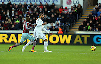 Pictured L-R: Enner Valencia of West Ham and Ashley Williams of Swansea Saturday 10 January 2015<br />