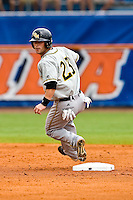 June 06, 2009:  NCAA Super Regional: Florida Gators vs Southern Miss Golden Eagles:   Southern Miss Taylor Walker 3B (23) rounds second base during game one of Super Regional action at Alfred A. McKethan Stadium on the campus of University of Florida in Gainesville.   Southern Miss defeated Florida 9-7 to take a 1-0 lead in the series............