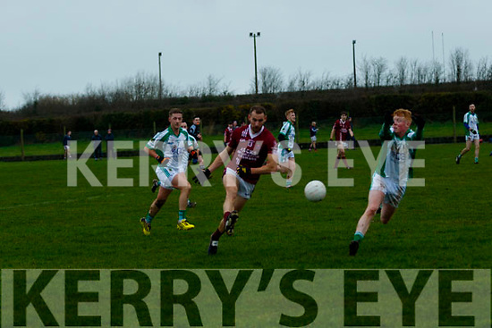 Brian Griffin, Ballybrown, looks to block down the shot from Sean O'Sullivan, Cromane, during their sides clash in the Munster Junior B Club Football Final in Knockaderry
