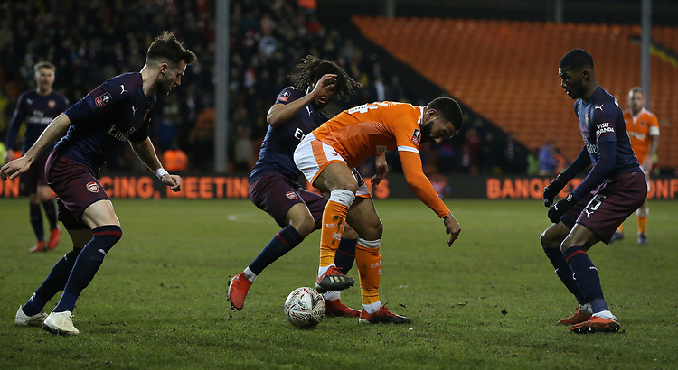 Blackpool's Liam Feeney battles with (L to R) Arsenal's Carl Jenkinson. Mohamed Elneny and Ainsley Maitland-Niles<br /> <br /> Photographer Stephen White/CameraSport<br /> <br /> Emirates FA Cup Third Round - Blackpool v Arsenal - Saturday 5th January 2019 - Bloomfield Road - Blackpool<br />  <br /> World Copyright © 2019 CameraSport. All rights reserved. 43 Linden Ave. Countesthorpe. Leicester. England. LE8 5PG - Tel: +44 (0) 116 277 4147 - admin@camerasport.com - www.camerasport.com