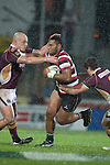 Samisoni Fisilau makes a run between David Hall and John Hardie. ITM Cup Round 4 and Ranfurly Shield rugby game between Counties Manukau Steelers and Southland, played at Rugby Park Invercargill, on Friday July 29th 2011..Southland won the game 22 - 14 after leading 13 - 6 at halftime.