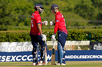 Tom Westley and Varun Chopra touch gloves between oversduring Middlesex vs Essex Eagles, Royal London One-Day Cup Cricket at Radlett Cricket Club on 17th May 2018
