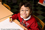 Parochial School Bronx New York  Kindergarten portrait of girl wearing glasses horizontal