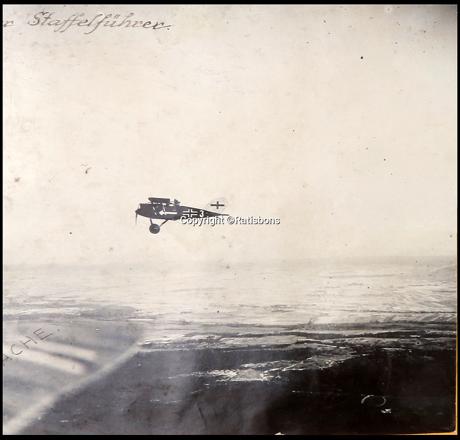 BNPS.co.uk (01202 558833)<br /> Pic: Ratisbons/BNPS<br /> <br /> Pilot Emil Buge took this air to air shot over the Western Front in 1918.<br /> <br /> A personal archive belonging to a hero German pilot of the First World War who fought to bring down the Nazis in the second has been discovered.<br /> <br /> Emil Buge flew on 37 sorties against the British on the Western Front, dropping 27 bombs, 128 grenades and firing 9,500 rounds of ammunition.<br /> <br /> Despite his heroics in 1918, Buge was imprisoned at a murderous concentration camp by his own country in the Second World War as a political prisoner. He used his position as an inmate clerk to gather evidence of SS atrocities.