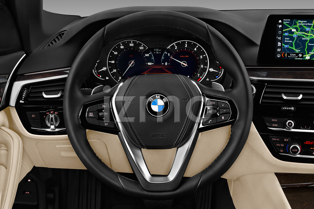 Car pictures of steering wheel view of a 2018 BMW 5 Series 530i 4 Door Sedan