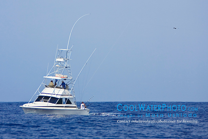 "Sport fishing boat, Ihu Nui, with Hawaiian ""Green Stick"" tuna rig, off Kona Coast, Big Island, Hawaii, Pacific Ocean."
