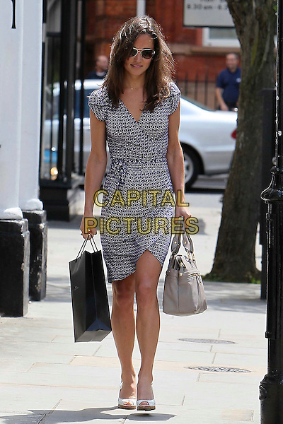 Pippa Middleton out and about in Chelsea, London, England..June 23rd, 2011.full length blue wrap print dress sunglasses shades shopping bags purse grey gray white peep toe wedges shoes .CAP/HIL.©John Hillcoat/Capital Pictures .