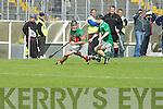 Tom Cronin (Crotta Capt) in action with Bobby O'Sullivan (Ballyduff) in the Garvey's SuperValu Senior Hurling Championship 2014 Quarter Finals at Austin Stack Park, Tralee on Saturday.