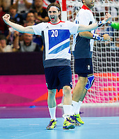 31 JUL 2012 - LONDON, GBR - Mark Hawkins (GBR) of Great Britain celebrates scoring during the men's London 2012 Olympic Games Preliminary round match against Sweden at The Copper Box in the Olympic Park, in Stratford, London, Great Britain .(PHOTO (C) 2012 NIGEL FARROW)