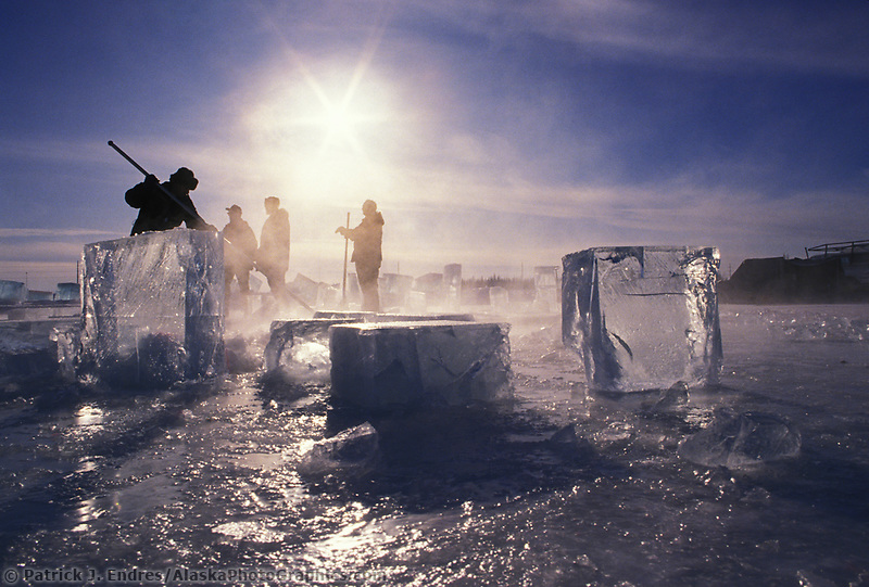 Harvest of large blocks of ice from a Fairbanks pond used by sculptors in the World Ice Art Championships held each march in Fairbanks, Alaska