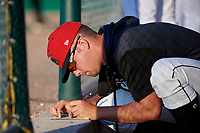 Batavia Muckdogs Andrew Miller (8) keeps notes during a NY-Penn League game against the Auburn Doubledays on June 18, 2019 at Dwyer Stadium in Batavia, New York.  Batavia defeated Auburn 7-5.  (Mike Janes/Four Seam Images)