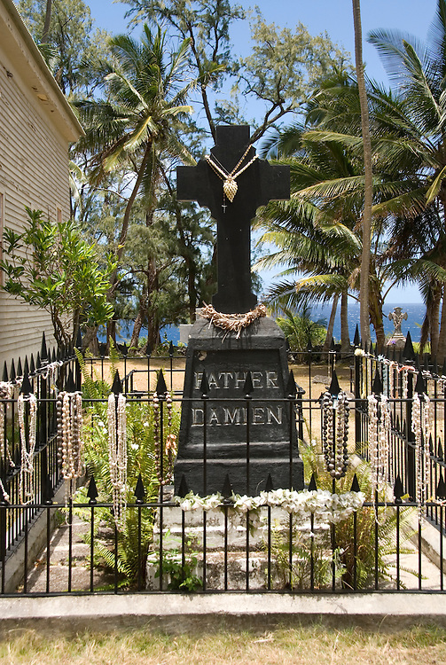 Hawaii: Molokai, church and gravesite at Kalawao of leper priest, Father Damien de Veuster..Photo himolo161-71895.Photo copyright Lee Foster, www.fostertravel.com, lee@fostertravel.com, 510-549-2202