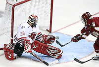 Denver's Drew Shore redirects the puck past UNO goalie John Faulkner to tie the game at 2-2 in the third period. Nebraska-Omaha beat Denver 5-2 Friday night at Qwest Center Omaha. (Photo by Michelle Bishop)