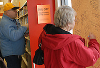 A customer leaves a message for the staff of B. Dalton bookstore in Westerville, Ohio, on the final day of sales at the bookstore. The store, one of the smallest in the chain, was closing after nearly two decades tucked in the corner of a building housing an insurance company and a balloon store.<br />