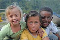 Amigos! Ecuadorian children of different skin colours together at an outdoor event in eastern Ecuador.