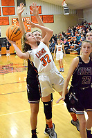 Westside Eagle Observer/MIKE ECKELS<br /> <br /> Kaylan Chilton (Lions 32) fights off a Lady Wolves player to put up a jumper during the third quarter of the Gravette-Lincoln varsity girls basketball contest in Gravette Dec. 3.