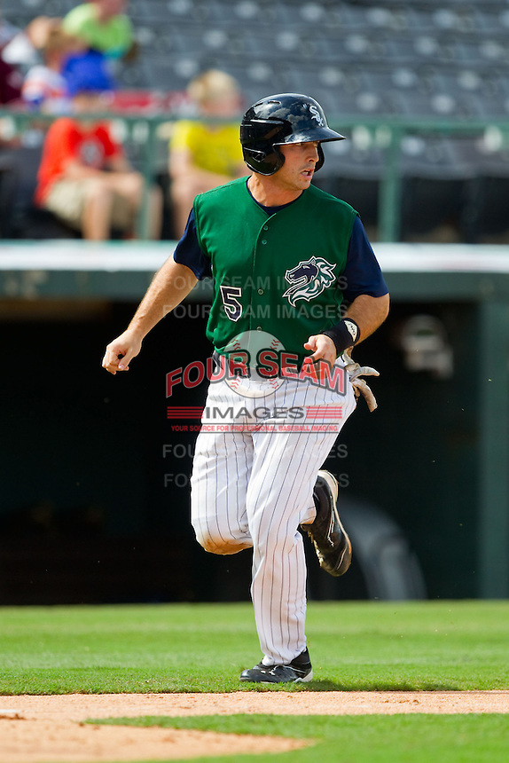 Michael Earley (5) of the Charlotte Knights trots down the third base line on his way to scoring a run against the Durham Bulls at Knights Stadium on August 18, 2013 in Fort Mill, South Carolina.  The Bulls defeated the Knights 8-5 in Game One of a double-header.  (Brian Westerholt/Four Seam Images)