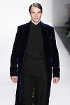 "Model walks runway A MEN'S SAPPHIRE SILK VELVET IMPERIAL ROBE LINED W/""ONE THOUSAND NIGHTS & ONE NIGHT LINING, MENS EBONY ITALIAN SILK DUPIONI TUXEDO SHIRT + BOW TIE, AND MEN'S EBONY ITALIAN SILK DUPIONI EVENING TROUSERS by Zang Toi, for the Zang Toi Spring 2012 My Dream Of North Africa Collection, during Mercedes-Benz Fashion Week Spring 2012."