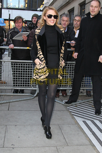 Kylie Minogue at BBC Radio 2, London, England..December 9th, 2011.full length black tights platform shoes jacket beige tiger animal print sleeveless jacket vest sunglasses shades .CAP/HIL.©John Hillcoat/Capital Pictures.