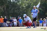 Andy Sullivan (ENG) is watched by caddie Sean as he lines up his putt to the 11th during the Final Round of the 2016 Omega Dubai Desert Classic, played on the Emirates Golf Club, Dubai, United Arab Emirates.  07/02/2016. Picture: Golffile | David Lloyd<br /> <br /> All photos usage must carry mandatory copyright credit (&copy; Golffile | David Lloyd)