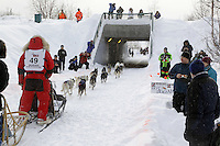 Saturday, March 3, 2012  Bob Chulpach and his dog team head into a tunnel near the Alaska Native Hospital during the Ceremonial Start of Iditarod 2012 in Anchorage, Alaska.