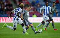 Lincoln City's Joe Morrell under pressure from Huddersfield Town's Trevoh Chalobah<br /> <br /> Photographer Andrew Vaughan/CameraSport<br /> <br /> The Carabao Cup First Round - Huddersfield Town v Lincoln City - Tuesday 13th August 2019 - John Smith's Stadium - Huddersfield<br />  <br /> World Copyright © 2019 CameraSport. All rights reserved. 43 Linden Ave. Countesthorpe. Leicester. England. LE8 5PG - Tel: +44 (0) 116 277 4147 - admin@camerasport.com - www.camerasport.com