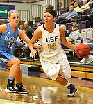 SIOUX FALLS, SD - DECEMBER 5:  Jaicee Ulmer #14 from the University of Sioux Falls gets a step past Madi Meier #4 from Upper Iowa in the first half of their game Friday night at the Stewart Center.  (Photo by Dave Eggen/inertia)
