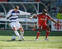11 April 2009:  FC Dallas forward Kenny Cooper #33 and Toronto FC defender Marvell Wynne #16 in action during an MLS game at BMO Field in Toronto between FC Dallas and Toronto FC. The game ended in a 1-1 draw.