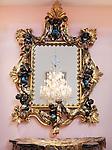 Decorative golden renaissance period mirror frame on a wall