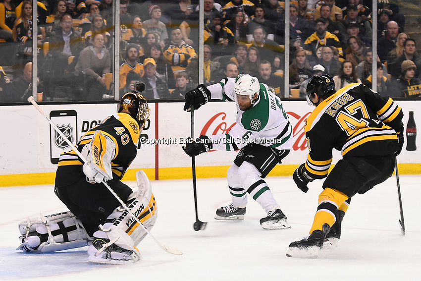 February 10, 2015 - Boston, Massachusetts, U.S. - Dallas Stars defenseman Trevor Daley (6) takes the puck to Boston Bruins goalie Tuukka Rask (40) during the NHL match between the Dallas Stars and the Boston Bruins held at TD Garden in Boston Massachusetts. Dallas defeats Boston 5-3 in regulation time. Eric Canha/CSM