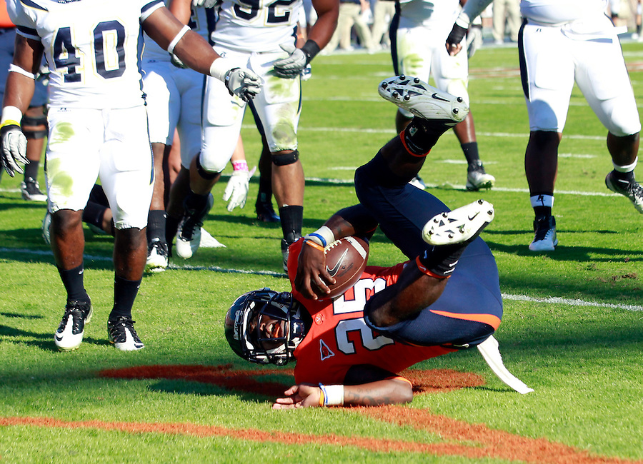 Oct. 15, 2011-Charlottesville, VA.-USA-  Virginia Cavaliers running back Kevin Parks (25) scores a first quarter touchdown during an ACC football game against Georgia Tech at Scott Stadium. Virginia won 24-21. (Credit Image: © Andrew Shurtleff