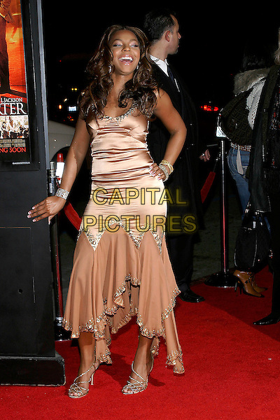 """ASHANTI.""""Coach Carter"""" Los Angeles Premiere at Grauman's Chinese Theatre, Hollywood, California, USA, 13 January 2005..full length peach bronze brown satin dress two materials gold beading beads beaded gold strappy shoes.Ref: ADM.www.capitalpictures.com.sales@capitalpictures.com.©Jacqui Wong/AdMedia/Capital Pictures ."""